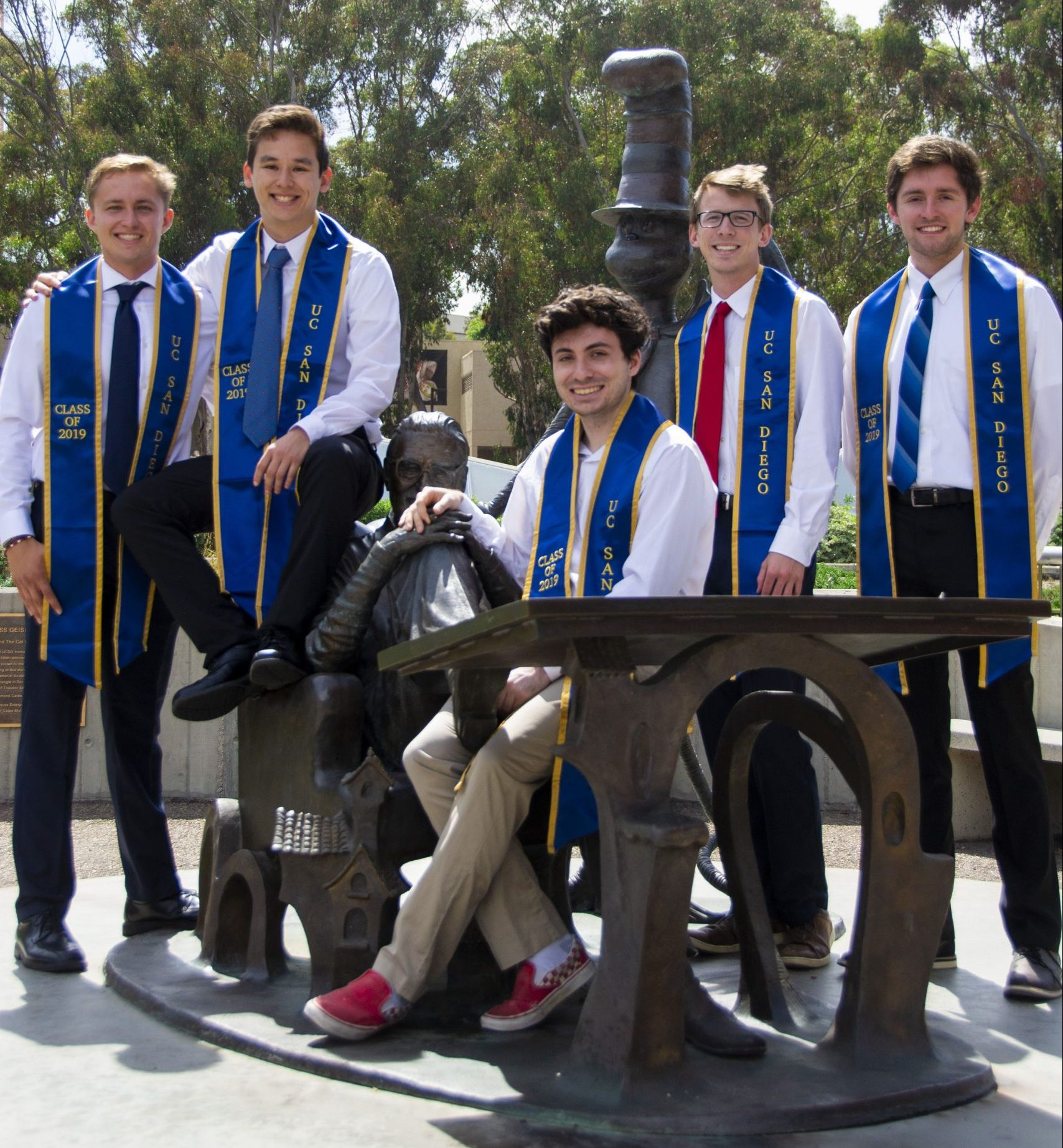 Group of students wearing their graduation stoles